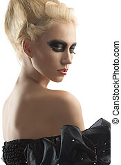 blonde girl with dark make-up looks down