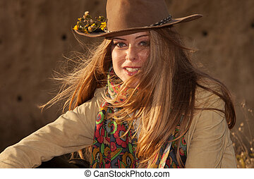 blonde girl with hat at sunset