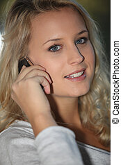 Blonde girl with mobile phone