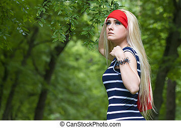 girl with red scarf and striped dress