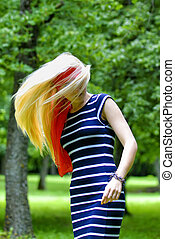 blonde girl with red scarf and striped dress