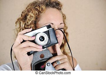 Blonde girl with retro camera