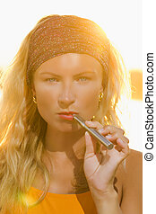 girl with the e-cigarette - blonde girl with the e-cigarette...