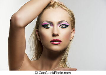 blonde girl's beauty portrait with hand on the head