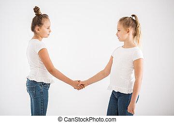Blonde girls shaking hands
