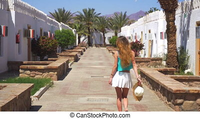 blonde goes around traditional egyption buildings -...