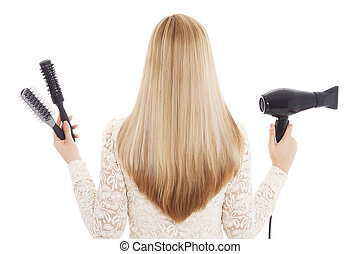 Blonde hair and hairdresser's tools - Stock Image