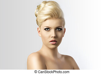 blonde hair style, the girl is in front of the camera