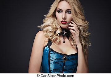 Blonde hair woman on dark background