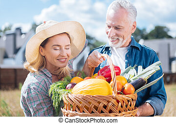 Blonde-haired family woman enjoying the view of their own harvest