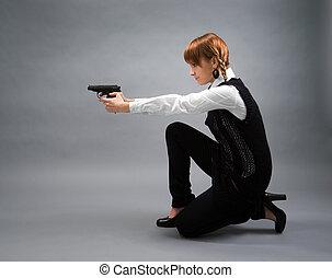 blonde holding a gun