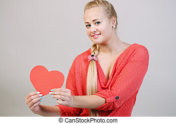 blonde holding a heart
