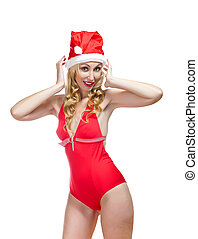 blonde in a bathing suit and a red New Year's hat