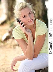 blonde in a garden