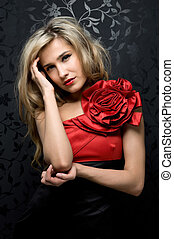 blonde in a red gown - Portrait of the beautiful blonde in a...
