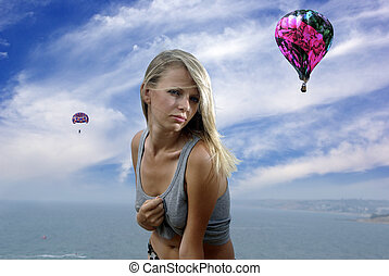 Blonde in a shirt against sky and sea
