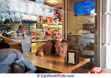 Blonde in a street cafe