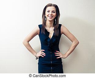 Blonde in black dress smiling