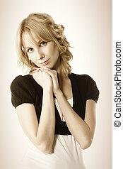Blonde in black top
