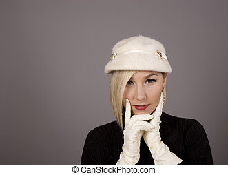 Blonde in Fur Hat and Two White Gloves - A blonde in a white...