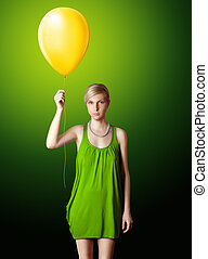 blonde in green dress with the yellow balloon