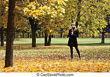Blonde in hat in the autumn park