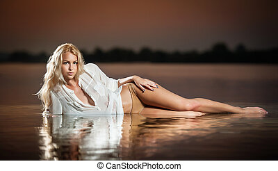 Blonde in water at sunset