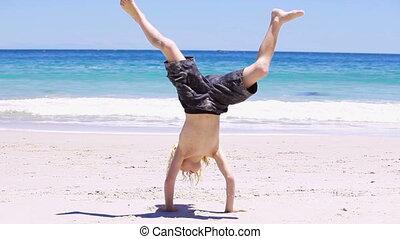 Blonde kid doing a handstand