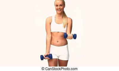 Blonde lady doing somes exercises isolated on a white...
