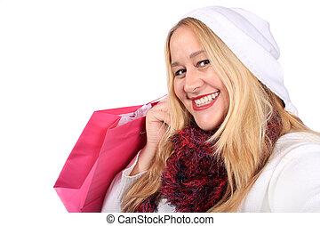 Blonde lady shopper in winter wear