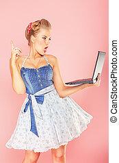blonde laptop - Smart pin-up girl posing over pink ...
