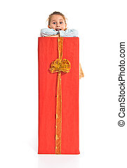 Blonde little girl holding a big red gift