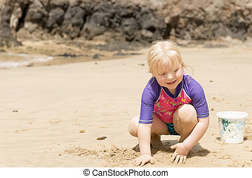 Blonde Little Girl Playing Sand it the Beach