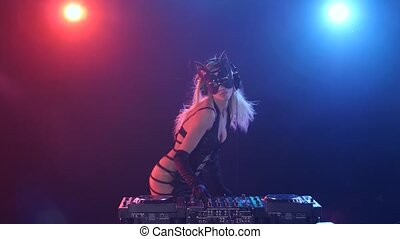 Blonde longhair girl dj in kitty mask and erotic dress