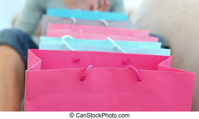 Blonde looking into shopping bags