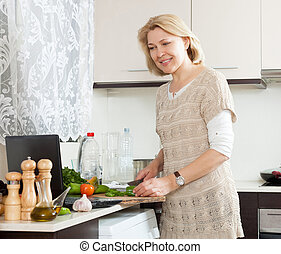 Blonde mature woman cooking