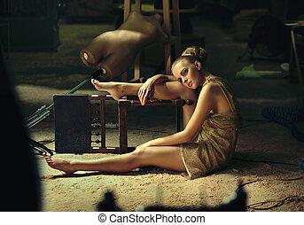 Blonde model posing in a grunge interior
