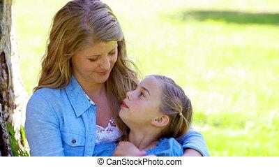 Blonde mother embracing her daughter