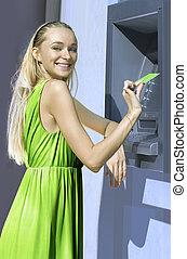 blonde near a cash machine - beautiful blond woman near a ...