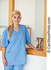 Blonde nurse looking at camera
