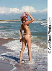 Blonde on a beach - Beautiful blonde in a hat and swimming ...