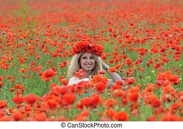 Blonde on the poppy field