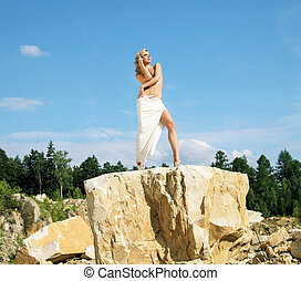 Blonde posing on the giant rock