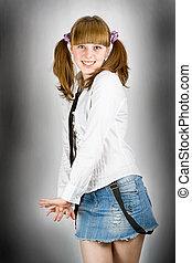 Blonde schoolgirl on grunge background