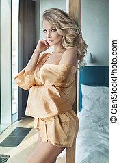 Blonde sensual woman posing.