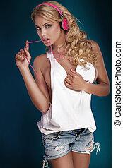 Blonde sexy woman listening music.