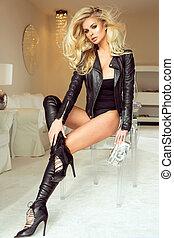 Blonde sexy woman posing.