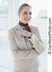 Blonde smiling businesswoman looking at camera
