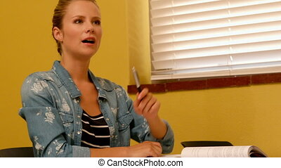 Blonde student putting her hand up