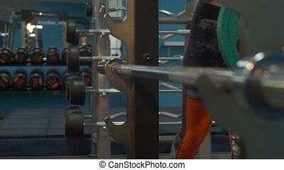 Blonde swinging in the gym